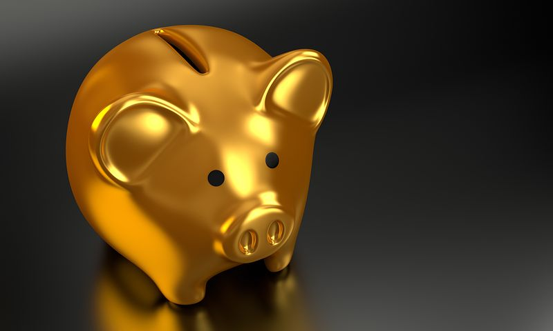 A golden piggy bank that represents 5 reasons why gold is the best investment | Nationwide Coin & Bullion Reserve