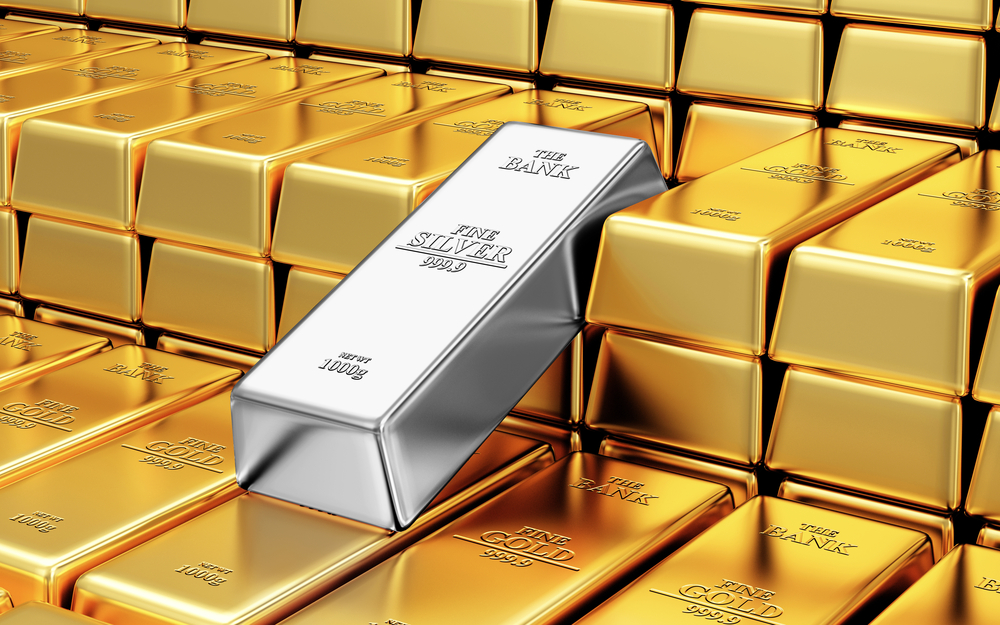gold bars with one silver bar