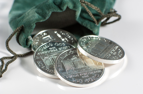 Coin pouch with silver coins falling out