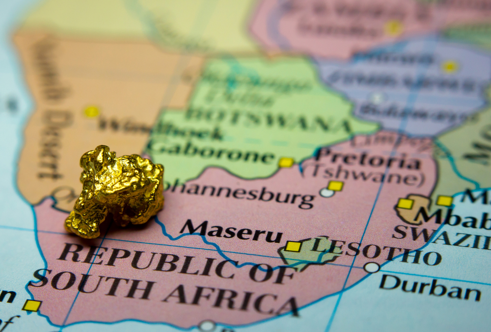 Map showing south africa with a piece of gold placed on top