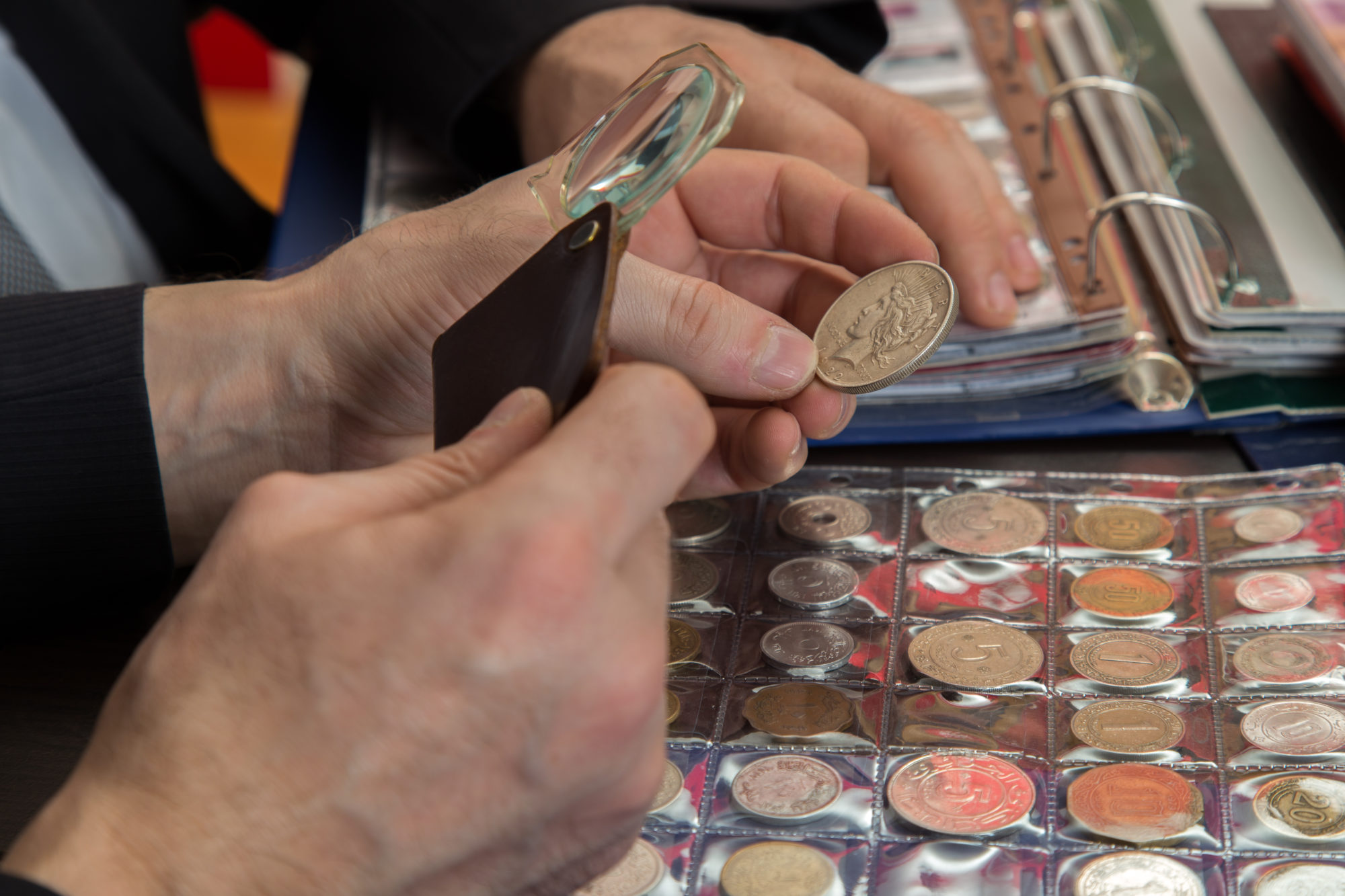 Coin collectors inspecting coins