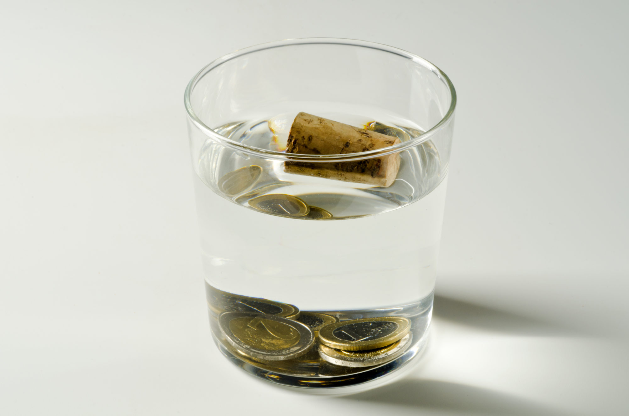 Gold coins sink in water